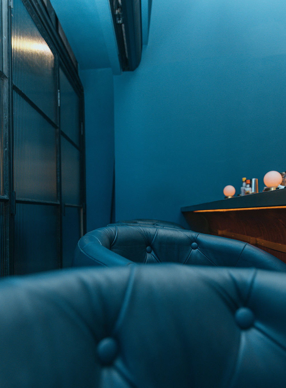 blue-leather-sofa-beside-brown-wooden-74.jpg